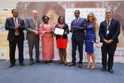 UNESCO-MARS 2016 'Best African Woman Researcher Award' 4th place winner Maria Nabaggala, from Infectious Diseases Institute, Uganda receives her award as Prof. Afework Kassu Gizaw, Minister of Science and Technology, Ethiopia; Prof. Dr Frank Stangenberg-Haverkamp, Chairman, Executive Board and Family Board of E.Merck KG; Sara Opendi, Minister of State for Health, Uganda; Prof. Yifru Berhane, Minister of Health, Ethiopia; Rasha Kelej, Chief Social Officer, Merck Healthcare and Ahmed Fahmi, Program Director, UNESCO