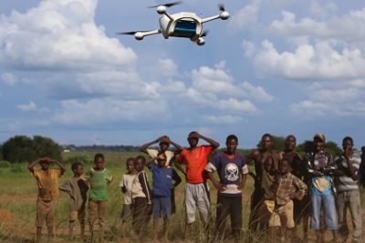 On 12 March 2016, children in Malawi look on amazed in the community demonstration of  Unmanned Aerial Vehicles (UAVs or drones) flying in Lilongwe. The Ministry of Health and UNICEF launched the first 10km auto programmed flight in a trial to speed up the testing and diagnosis of HIV in infants. Malawi has a national HIV prevalence rate of 10% - still one of the highest in the world. An estimated 1 million Malawians were living with HIV in 2013 and 48,000 died from HIV-related illnesses in the same year. Whilst progress has been made, and today 90% of pregnant women know their HIV status, there is still a drop off with testing and treating babies and children. In 2014, around 10,000 children in Malawi died from HIV-related diseases and less than half of all children were on treatment.    Samples are currently transported by road, either by motorbike or local authority ambulances. Various factors including the high cost of diesel fuel, poor state of roads and limited distribution schedules have resulted in extreme delays in lab sample transport, constituting a significant impediment for the scaling up of paediatric ART's effectiveness.    In March 2016,  the Government of Malawi and UNICEF have started testing the use of Unmanned Aerial Vehicles (UAVs or drones) to explore cost effective ways of reducing waiting times for HIV testing of infants. The test, which is using simulated samples, will have the potential to cut waiting times dramatically, and if successful will be integrated into the health system alongside others mechanisms such as road transport and SMS.  The first successful test flight completed the 10km route unhindered travelling from a community health centre to the Kamuzu Central Hospital laboratory.  Local residents gathered in amazement as the vehicle took off and flew away in the direction of the hospital. The test flights which are assessing viability including cost and safety, will continue until Friday 18th March.