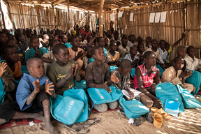On 7th November 2016, children attend a class at a primary school in Muna Garage IDP camp, Maiduguri, Borno State, Nigeria. There are nearly 2,000 children enrolled at the UNICEF supported - in partnership with the government - school in the camp. With the assistance of UNICEF and partners, over 88,000 children have access to safe learning spaces in north-east Nigeria and almost 155,000 children have been reached with learning materials.