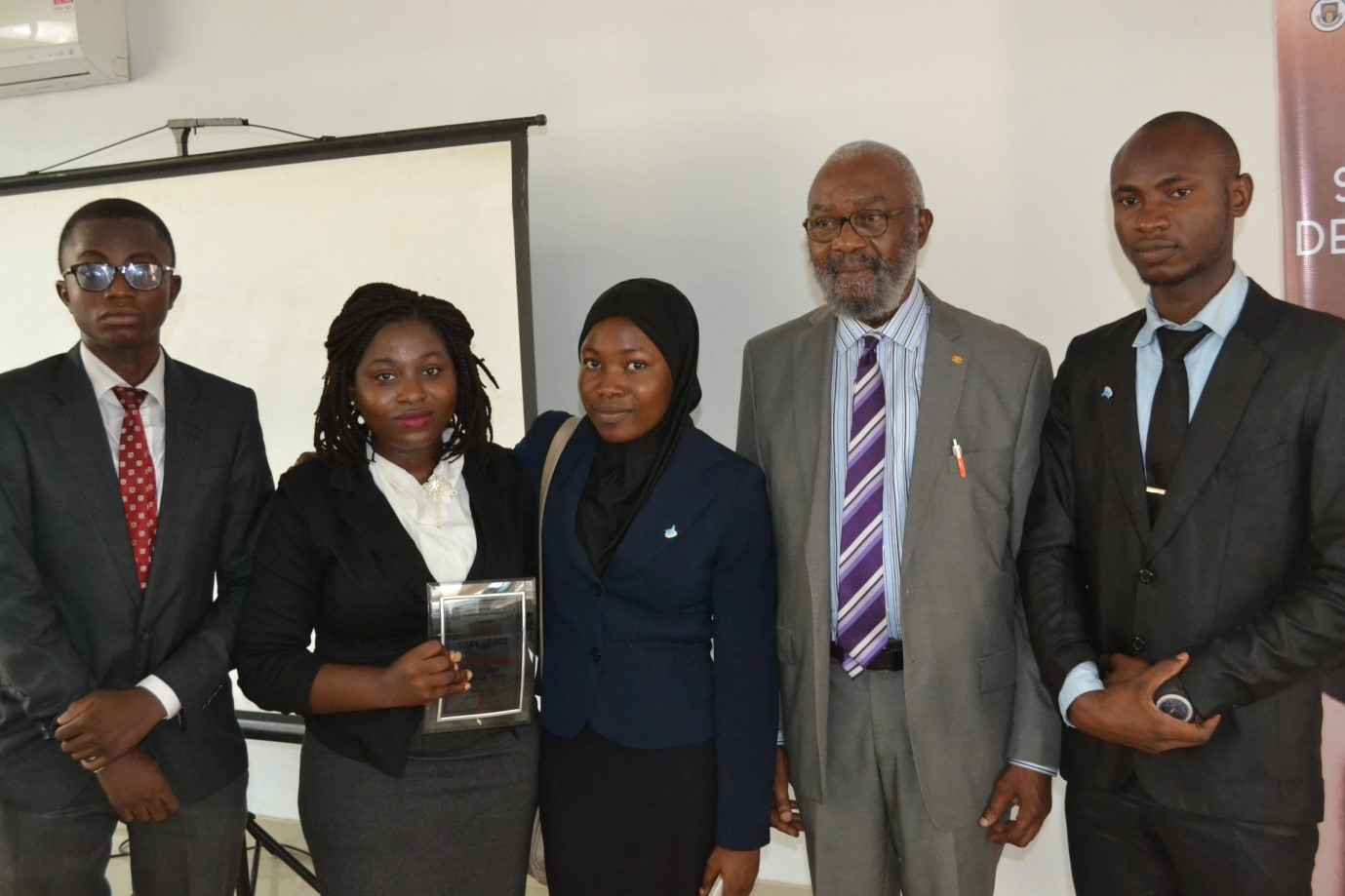 2017 WINNERS: Kazeem Folarin (also won 'Best Chief Speaker' award), Temiwunmi Akinmuleya, Khadeejah Babalola and Aliu Raji in a group photograph with the patron, Sir Ifeanyi Atueyi