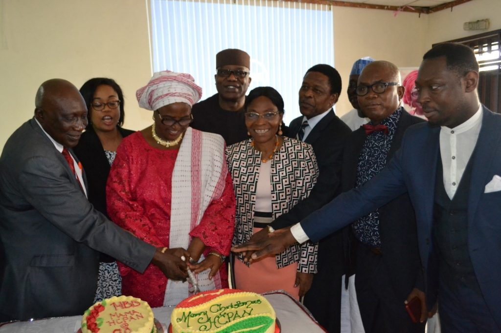 A cross section of HCPAN members cutting the birthday cake with Princess (Dr) Adenike Olaniba fondly christened 'Mama Health Insurance' (middle).